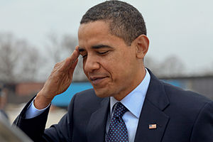 English: President Barack Obama salutes at And...