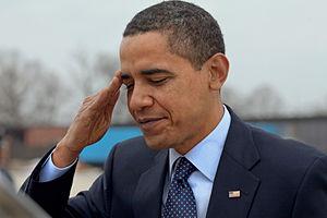 English: President Barack Obama salutes at And...